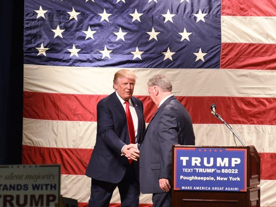 Donald Trump greets Dutchess County Sheriff Butch Anderson during a rally at the Mid-Hudson Civic Center in Poughkeepsie on April 17, 2016.