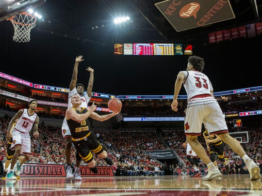 Northern Kentucky's Tyler Sharpe is fouled by Louisville