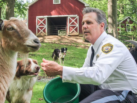 Ross Licitra, the new chief law enforcement officer for the Monmouth County Society for the Prevention of Cruelty to Animals, with some of his many rescues on his family farm in Marlboro.