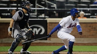 New York Mets' Curtis Granderson hits a grand slam home run during the ninth inning of a baseball game against the New York Yankees Thursday, Aug. 17, 2017, in New York. The Yankees won 7-5.