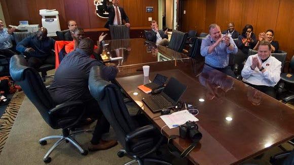 The Auburn coaching staff celebrates WR Nate Craig-Myers committing to Auburn on National Signing Day in Auburn, Ala. on Wednesday, Feb. 3, 2016.
