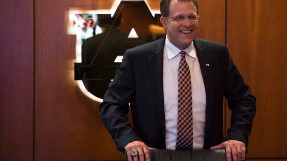Auburn head coach Gus Malzahn celebrates during National Signing Day in Auburn, Ala. on Wednesday, Feb. 3, 2016.