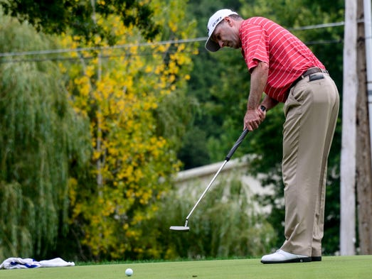 Kevin Sutherland makes a 45-foot putt on the 11th hole during the second round of the Dick's Sporting Goods Open on Saturday at En-Joie Golf Course in Endicott. Sutherland shot 59 to set a Champions Tour single day scoring record.