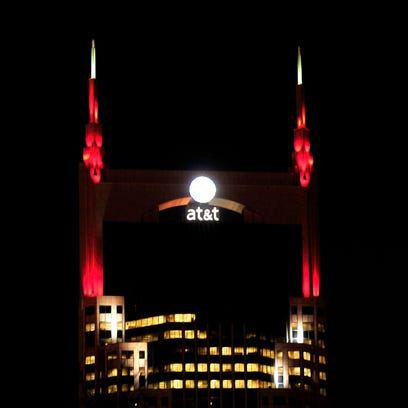 The AT&T building is lit up in red to mark the 12th