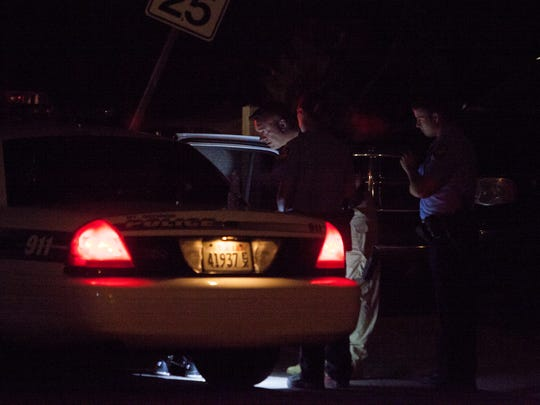 Police officers question a suspect in a stabbing incident in Dixie Downs Tuesday, Oct. 27, 2015.