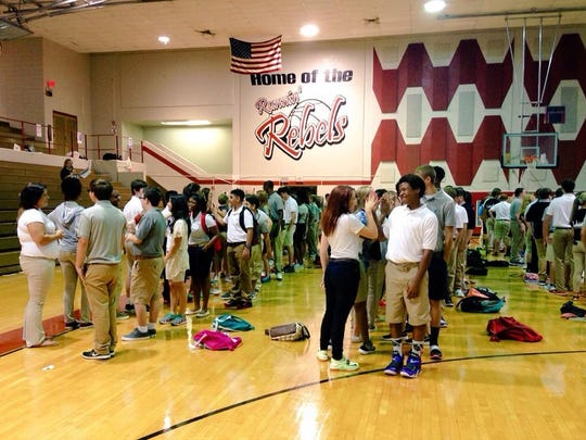 Pineville High School freshmen get to know each other through an interactive game of high-fives and interesting questions on their first day of high school Monday.