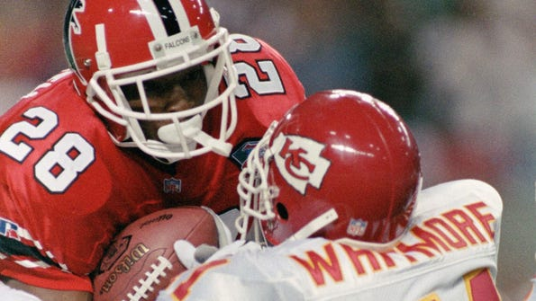 Falcons running back Tony Smith is hit by Chiefs safety David Whitmore during the opening kickoff of their game Sept. 18, 1994, in Atlanta. Smith spent three seasons in the NFL.
