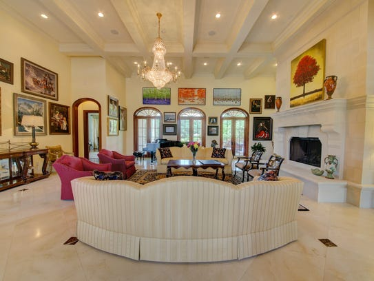 The formal living room is large and elegant.