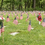 Flags mark the graves as part of the Memorial Day service at Ft Custer National Cemetery.