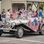Old cars make their way down Michigan Avenue in the Memorial Day Parade in Marshall on Monday.