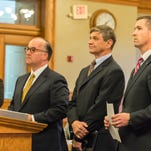 "Former Summit Pointe CEO Erv Brinker, second from right, appears in court in Mason with his attorneys Matthew Vicari, second from left, and Patrick O'Keefe, right. Michigan Assistant Attorney General Jeffrey Schroder is at far left. Brinker pleaded guilty to three felonies on Wednesday, admitting he paid the associate of a Key West, Fla., psychic with public funds under what was described as ""bogus"" contracts."
