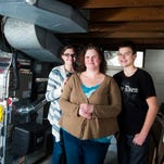 """Tabitha Staub, with her son Steven Hardy, 14, and daughter Gabrielle Hardy, 18,  were part of the """"The Gift of Warmth"""" program sponsered by United Way, BGE HOME and Constellation Home. The family was gifted with a new heating and cooling system from the program after discovering their new home's original system was faulty."""