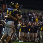 Littlestown's Tyler Runkles is congratuled after catching a 13-yard pass near the end zone that set up the only touchdown  of the game  against Delone Catholic on Friday Sept. 30, 2016 at Littlestown High School.