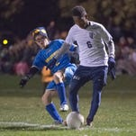 Broadfording's Jacob Thornsbury (2) tries to steal the ball from Peter Livermore (6) of Shalom during the MDCC boys soccer championship game on Friday, Oct. 22, 2016.