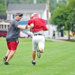 Successful championship-winning football coach Frank Gay re-hired at Red Land