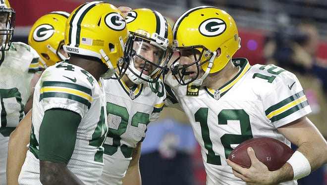 Green Bay Packers receiver Jeff Janis (83) celebrates his touchdown reception with quarterback Aaron Rodgers (12) against the Arizona Cardinals at University of Phoenix Stadium.