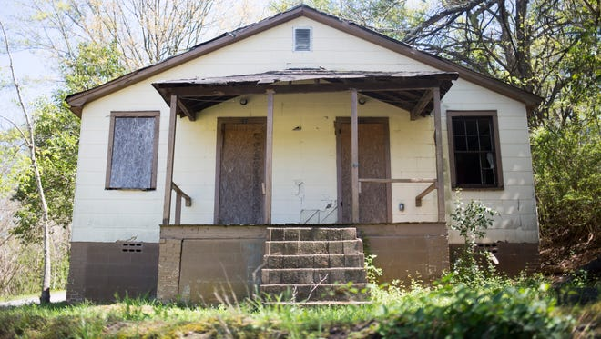 A dilapidated property at 225 Caughlin Ave. is one of 11 that will be demolished under a contract approved Monday night by the Anderson City Council.