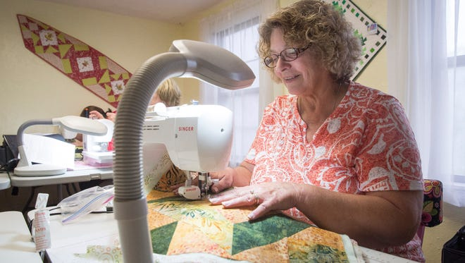 Sheila Gordon works on a placemat Monday afternoon at the Cotton Candy Quilt Shoppe during a class offered by Tish Wright.