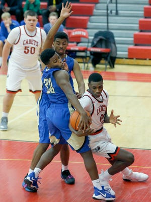 Webster Schroeder's Malachi Duval and Hilton's Tah'Jae Hill battle for the ball in the second quarter at Hilton High School.
