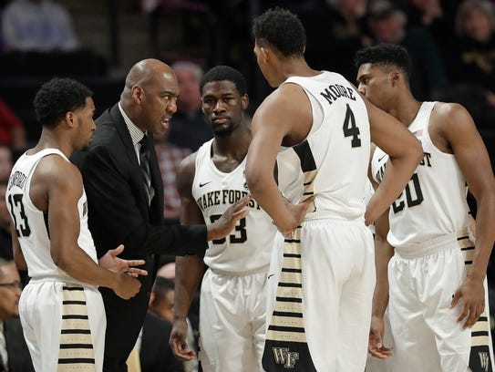 Wake Forest head coach Danny Manning, second from left,