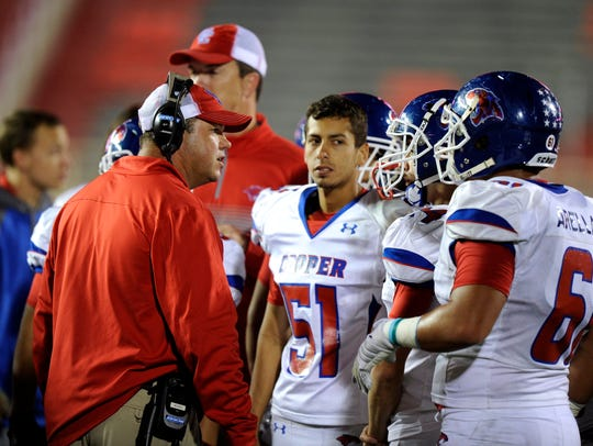 Cooper head coach Todd Moebes talks to his players