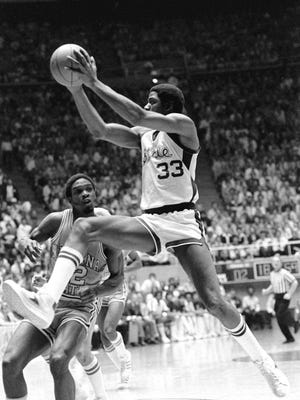 """Michigan State's Earvin """"Magic"""" Johnson (33) goes high for a layup March 26, 1979, during the NCAA Championship game against Indiana State at Salt Lake City, Utah.  NY902"""