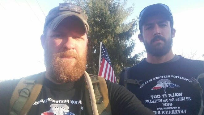 Pictured from left, Jason Ladd, and Nathan Fielder walking 22 miles to show support for an organization that helps veterans dealing with suicidal thoughts. Ladd served four tours of duty in the Middle East.