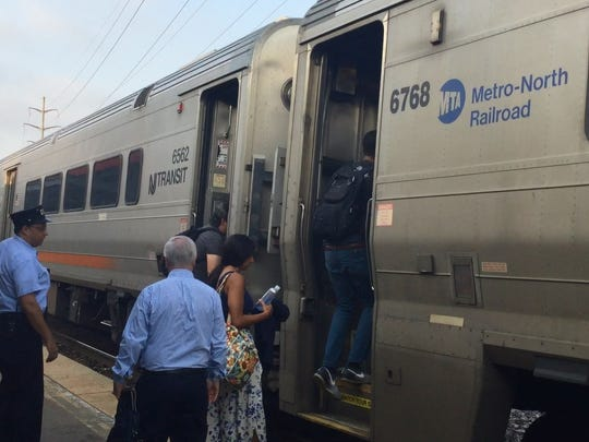 Commuters board a Pascack Valley Line train at Pearl