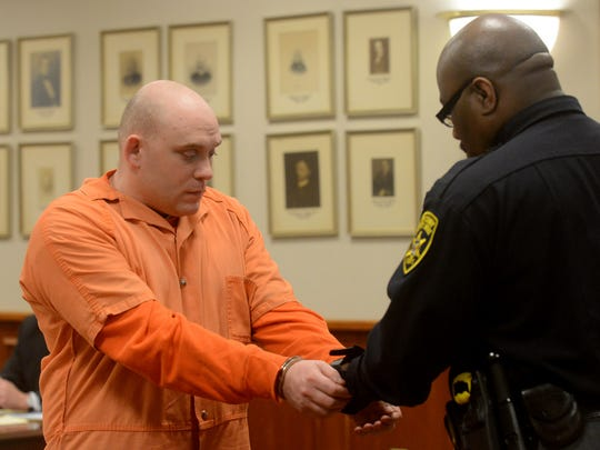 Kenneth Stahli has his handcuffs removed while in court last month.