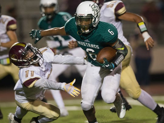 King's Bryson Nathaniel Butler runs the ball during the third  quarter of their game against Tuloso-Midway at Buccaneer Stadium on Thursday, Sept. 21, 2017.