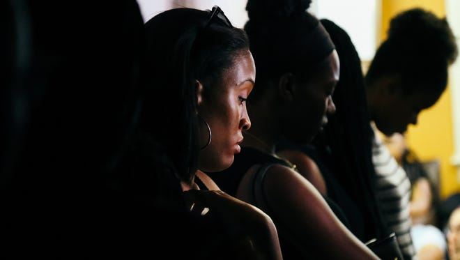 A young woman quietly cries during the BSU Uncensored event, which gave students an open forum to process their feelings about recent police violence.