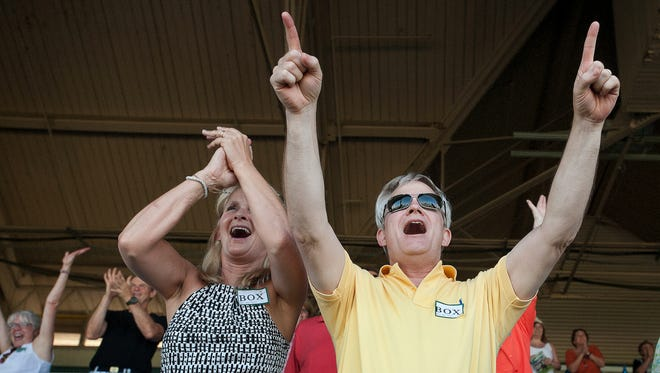 Elizabeth and Rick Paulsen of Louisville react ecstatically as they view the Belmont Park simulcast from the clubhouse box seats of Churchill Downs as American Pharaoh ridden by Victor Espinoza cruises to win the Triple Crown in Belmont Park.06 June 2015