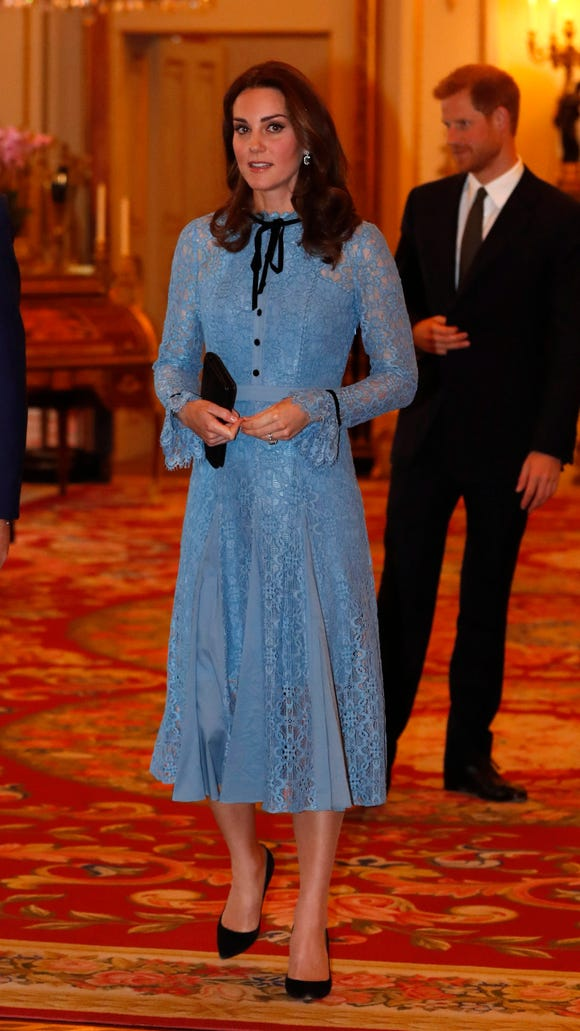 Duchess Kate returned to work in a blue lace Temperley London dress.