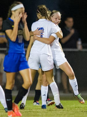 Memorial's Elise Milligan (7) celebrates with teammate Isabel Alexander (2) after Alexander's goal during the girls soccer sectional semifinal against Castle at Castle High School in Newburgh, Thursday, Oct. 6, 2016.