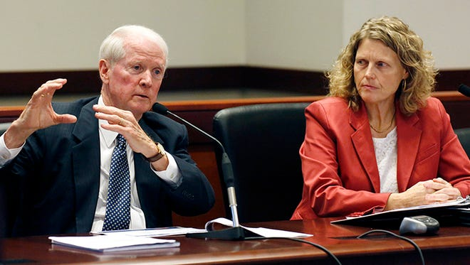 Central Mississippi Transportation Commissioner Dick Hall, left, responds to a lawmaker's question while Melinda McGrath, executive director of the Mississippi Department of Transportation, during a hearing before the Joint Legislative Budget Committee, Wednesday, Oct. 1, 2014, in Jackson, Miss.