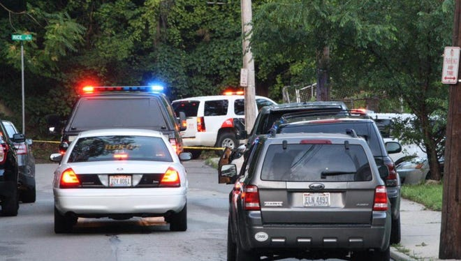 Police investigate the scene after a University of Cincinnati police officer shot and killed a suspect following an altercation and traffic stop Sunday evening.