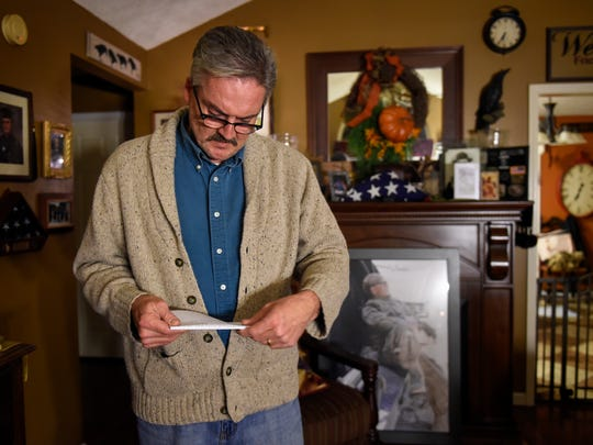 David Toombs reads part of his son's suicide note as he was interviewed on Wednesday, Dec. 7, 2016, at his home in Murfreesboro, Tenn. His son was Tennessee Army National Guard Sgt. John Toombs, who committed suicide in Murfreesboro in late November.