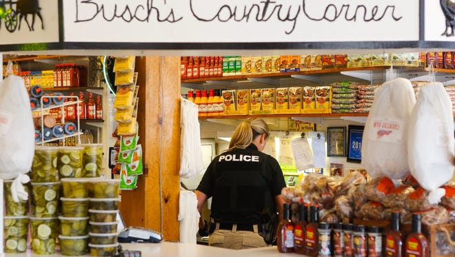 Investigators seize property at Busch's County Corner inside Findlay Market in Over-the-Rhine on May 10, 2018.