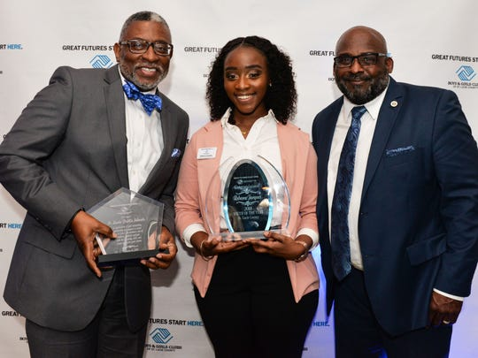 Dr. Kevin Perry, Assistant St. Lucie Public Schools Superintendent, and Will Armstead, Chief Executive Officer of Boys and Girls Clubs of St. Lucie County, help Rebecca Jacques with her awards after the Youth of the Year winner was announced.