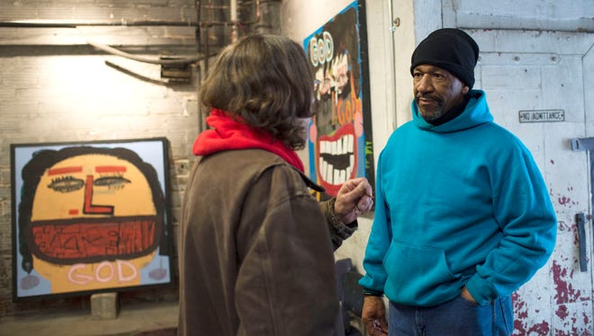 From left, Dan Varani of Jackson talks to Heidelberg Project founder Tyree Guyton during 'Steppin' Out!', an open studio and art sale at the gallery on Watson Street in Detroit on event on Saturday, March 25, 2017.