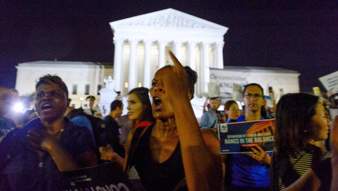 Pro-life and pro-choice groups clash outside of the Supreme Court to protest or support Donald Trump's Supreme Court Justice Nominee, Judge Brett Kavanaugh, to replace Justice Kennedy, July 9, 2018.