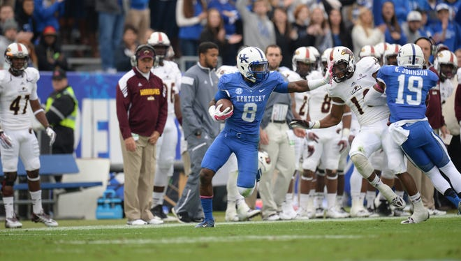 UK WR Javess Blue runs with the ball after the catch during the first half of the University of Kentucky Wildcats Football game against Louisiana-Monroe in Lexington, KY. Saturday, October 11, 2014.