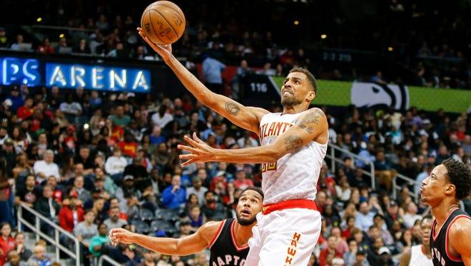 Atlanta Hawks forward Thabo Sefolosha (25) shoots the ball against the Toronto Raptors in the third quarter at Philips Arena.