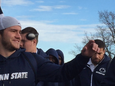 Penn State seniors from left: Ben Kline, Carl Nassib and Angelo Mangiro participate in their last on-field singing of the school's alma mater following the Nittany Lions' 28-16 loss to Michigan on Saturday.