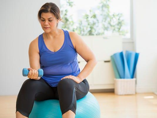 636340803961890288-woman-lifting-weights.jpg