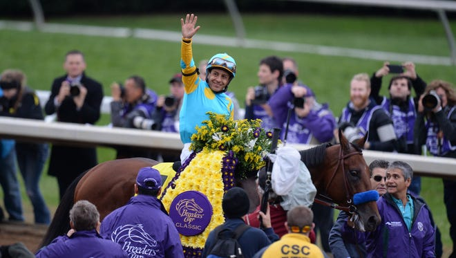American Pharaoh with Victor Espinoza wins the Classic during the Breeders' Cup World Championships at Keeneland Race Course in Lexington, Ky., on Saturday, October 31, 2015. 