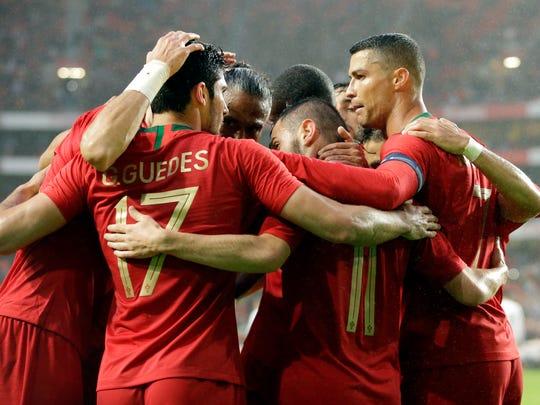 Portugal celebrates a goal during a friendly against Algeria.