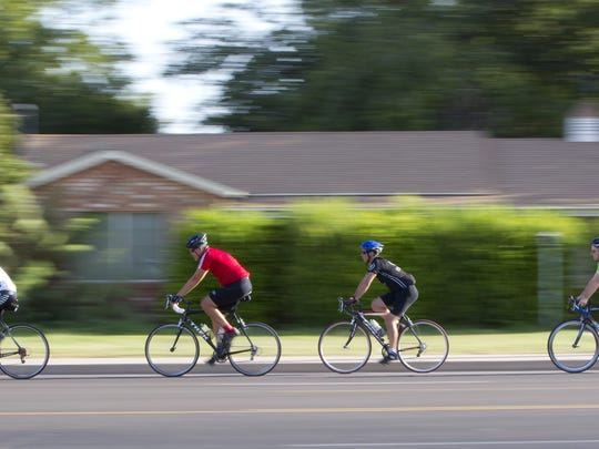 Cyclist ride on west on 8th St. near Extension in Mesa.