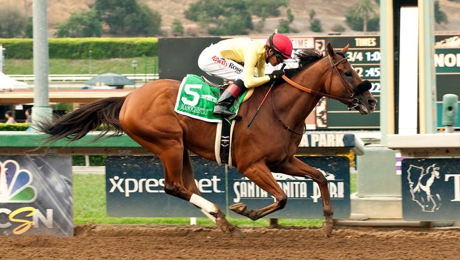 Masochistic and jockey Tyler Baze win the Grade I $300,000 Triple Bend Stakes  Saturday,  June 27, 2015 at Santa Anita Park, Arcadia, CA.  