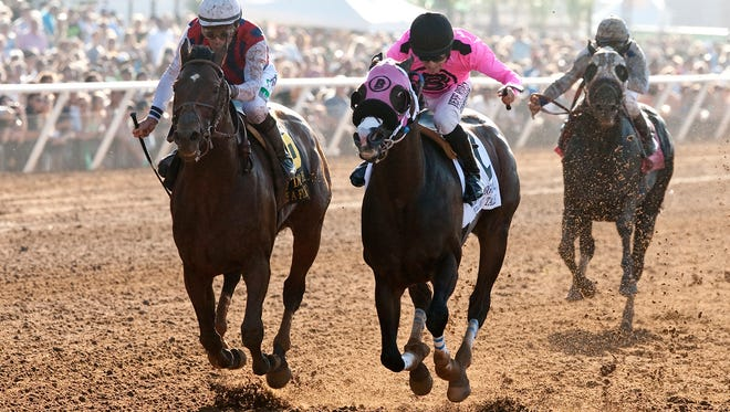 Catch A Flight and jockey Gary Stevens, left, roar up on the outside in time to collar Appealing Tale (Joe Talamo), right, for victory in the Grade II $200,000 San Diego Handicap Saturday, July 25, 2015 at Del Mar Race Track, Del Mar, CA.